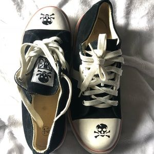 Black suede sneakers with skull and cross bones